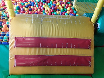worn ball pit entry ramp in childrens play area