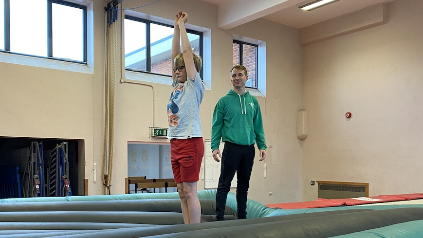 Gymnast and Coach on AirPit landing mat