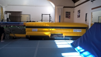 Yellow Airpit landing mat with side walls