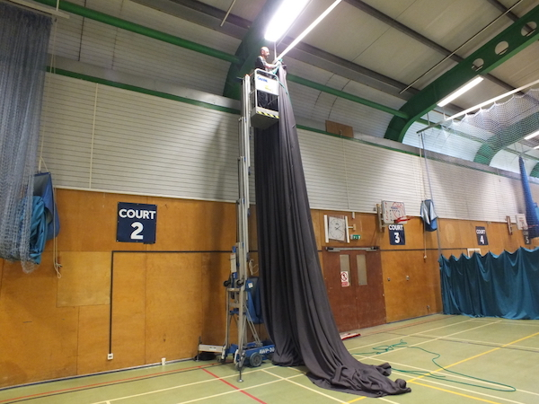 MDS Leisure use high lift machinery to assist with repairing sports arena nets and curtains