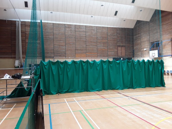 Fitted repaired sports hall net curtain